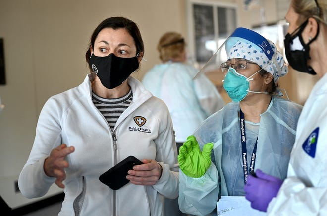 """Alexandra DePalo, left, Framingham's interim public health director, said she was """"really pleased"""" that the city is no longer tagged with the state's highest-risk """"red"""" designation for the coronavirus. But she says there is still work to be done."""