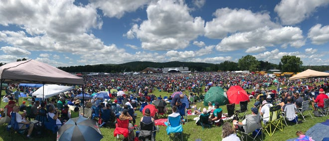 People take in the Baseball Hall of Fame's induction ceremony during 2019 in Cooperstown. The Hall of Fame is altering the induction ceremony for 2021, shifting to a televised event in July for its class that includes Derek Jeter. The 2020 event was canceled because of the pandemic.
