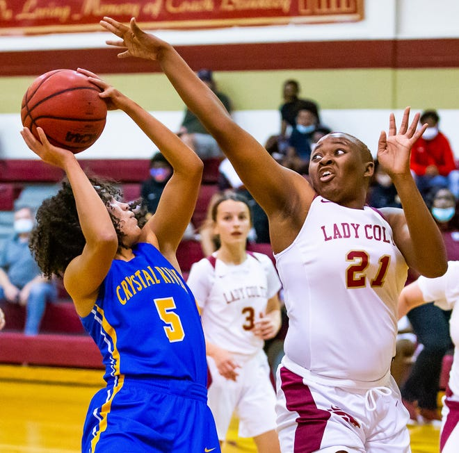 North Marion's Jermaya Jackson blocks a shot by Crystal River's Alysa Jenkins. The North Marion Colts lost to the Crystal River Pirates, 62-56, in the 4A regional quarterfinals Thursday night.