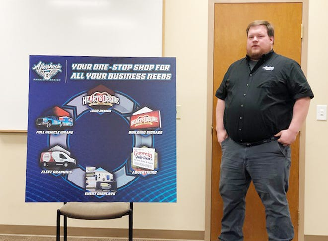 Kirk Leman, owner of Aftershock Decals and Design in downtown Fairbury, appears before the Fairbury Rotary Club on Tuesday.