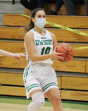 Dwight senior Kayla Kodat eyes the basket during a game earlier this season. Kodat scored 22 points to lead the Trojans past Iroquois West Thursday. She also surpassed the 1,000-point mark in career scoring in the win.