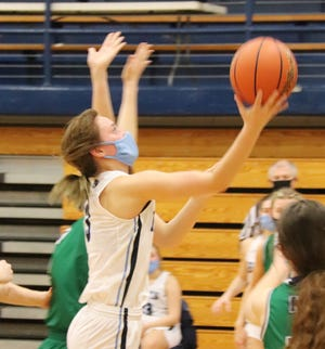 Prairie Central's Madison Kinkade, shown here in a game against Peoria (Notre Dame) scored 14 points for the Hawks in a home loss to Bloomington (Central Catholic) Thursday.