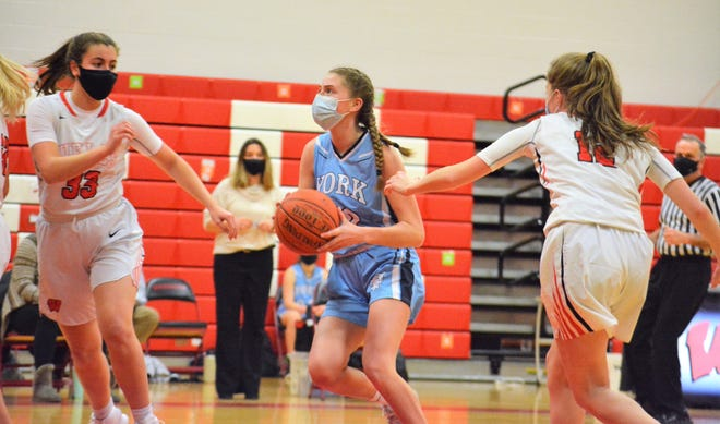 York's Kristen Leroux, center, drives between Ruby McMinis, right, and Grace Ramsdell, left, during Wednesday's season-opening girls basketball game in Wells, Maine.