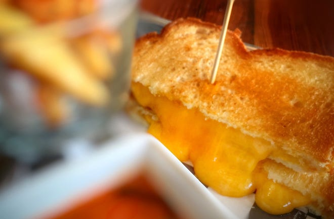 Buttery toasted bread with warm, molten, gooey cheese inside is pretty close to heaven at the Grilled Cheese Gallery, which just opened a location at the Palm Beach Outlets.