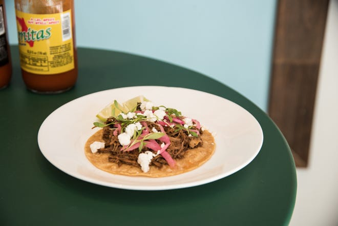 At Bonitas, a braised lamb barbacoa taco dotted with goat cheese.