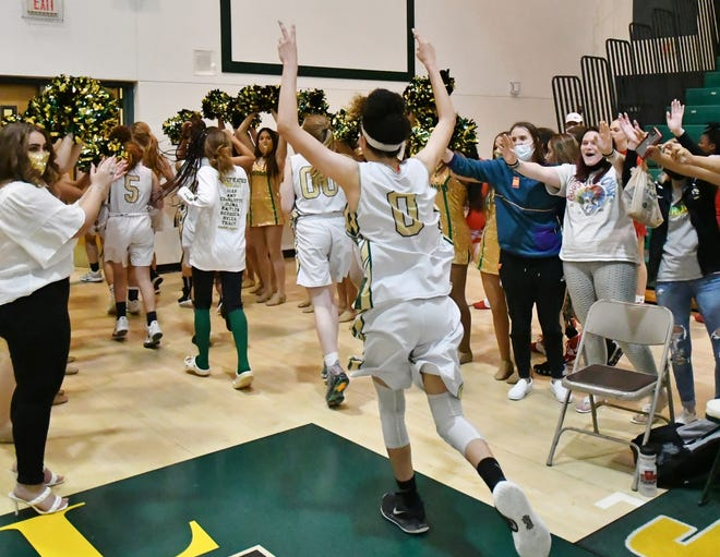 Jupiter senior Aayden Ghee celebrates with teammates after the victory against visiting Vero Beach in the regional quarterfinals. Ghee led the Warriors with 21 points in the game.