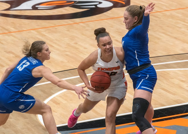 Pacific's Valerie Higgins, center, drives on BYU's Paisley Harding, left, and Tegan Graham during a WCC women's basketball game at Spanos Center in Stockton.