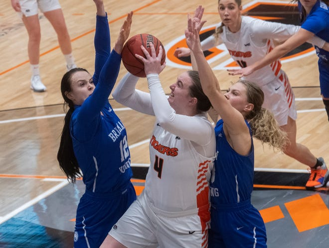 Pacific's Rosie Schweizer, center, goes to the hoop between BYU's Lauren Gustin, left, and Paisley Harding during a WCC women's basketball game at Spanos Center in Stockton.