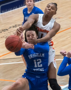 Pacific's Brooklyn McDavid, top, fights for a rebound with BYU's Lauren Gustin during a WCC women's basketball game at Spanos Center in Stockton earlier this season.