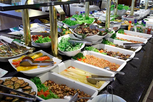 A self-serve salad bar and buffet.