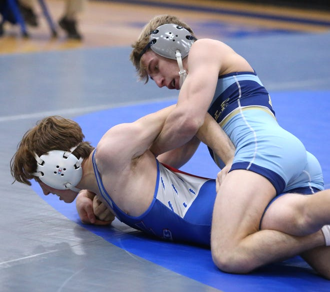 Dan Adams (top) of Louisville defeated Dakota Whitacre of Lake in a 120 pound bout at Lake on Thursday, Feb. 11, 2021.