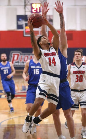 Malone's Bryce Butler — going up for a shot against Hillsdale, Feb. 11, 2021 — is averaging a team-best 18.4 points per game this season for the Pioneers.
