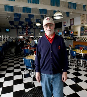 Joe Beasley, owner of Lake Varsity Diner, is facing civil action from county officials because he doesn't require employees or customers to wear a mask while at the Lake Township restaurant. His court hearing was delayed Tuesday after technical issues and his refusal to wear a mask if he went to the Stark County Courthouse.
