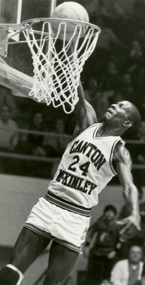 McKinley All-Ohio guard Gary Grant dunks during a game at the Field House. Grant led the Bulldogs to their first state title in 1984.