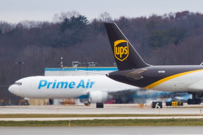 UPS and Prime Air cargo planes travel on the tarmac on Wednesday, Nov. 27, 2019, at Chicago Rockford International Airport in Rockford.
