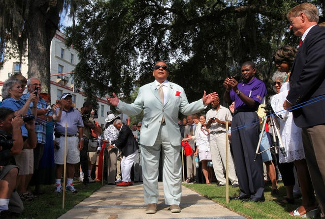 Andrew Young speaks as he walks over a sidewalk monument commemorating the June 9, 1964, march for civil rights in St. Augustine during the dedication in the Plaza de la Constitucion on Saturday, June 11, 2011.