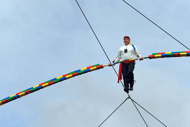 Legoland Florida Resort in Winter Haven kicked off its 10th birthday on Friday with a wirewalk by world-famous seventh-generation aerialist Nik Wallenda. The funambulist traversed a 600-foot-long cable suspended 60 feet off the ground.