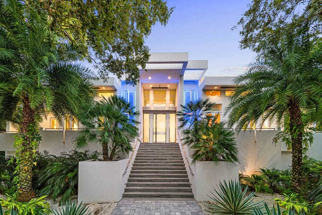 The estate at 1452 Hillview Drive in Sarasota's Harbor Acres neighborhood includes roughly $4 million in upgrades, including smart-home technology, a temperature-controlled wine cellar, an infinity edge pool, and a 10-car drive-through garage.