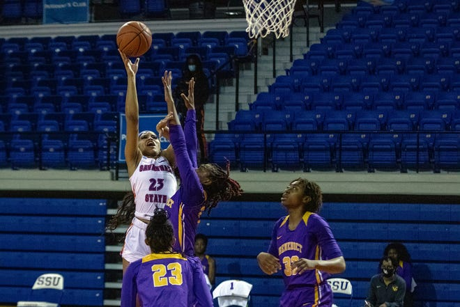 Savannah State's Amari Heard (23) shoots a one-handed shot against Benedict College on Thursday night at Tiger Arena, which is closed to the public for games this season because of the COVID-19 pandemic. Benedict won the game 81-63 in SSU's season opener.