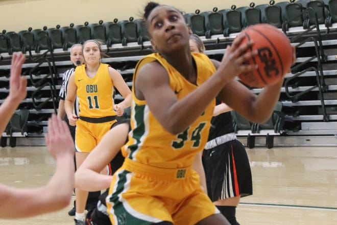 OBU's Kalifa Ford (34) goes up for two points against East Central Thursday night at the Noble Complex.
