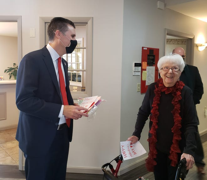 Sen. Win Stoller personally delivers a Valentine's Day card to Kewanee Courtyard Estates resident Dorothy Schmidt on Friday. The newly-sworn in senator traveled to several locations throughout his district and delivered 600 cards made by students and other organizations to seven nursing homes.