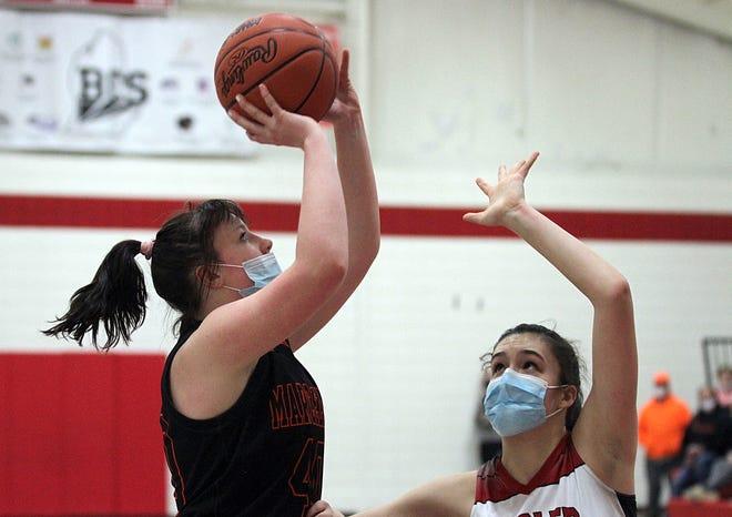Jenna Wells knocks down a shot against Howardsville Christian on Thursday.