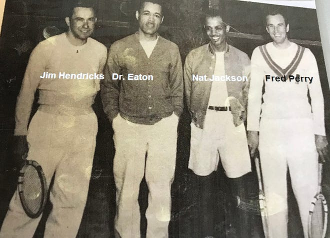 From left, a photo from the day when Wilmington tennis star Nathaniel Jackson played Wimbledon champion Fred Perry in an exhibition match on the court at 1406 Orange St. From left, Jim Hendricks, Dr. Hubert Eaton Sr., Nathaniel Jackson and Fred Perry.