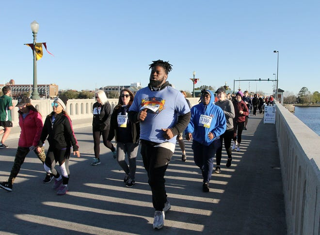 Runners in this 2019 photo participate in the Neuse River Bridge Run in historic New Bern, N.C., March 23, 2019. The Neuse River Bridge Run fundraiser serves the community by promoting a healthy,active lifestyle and through its financial support of community organizations.