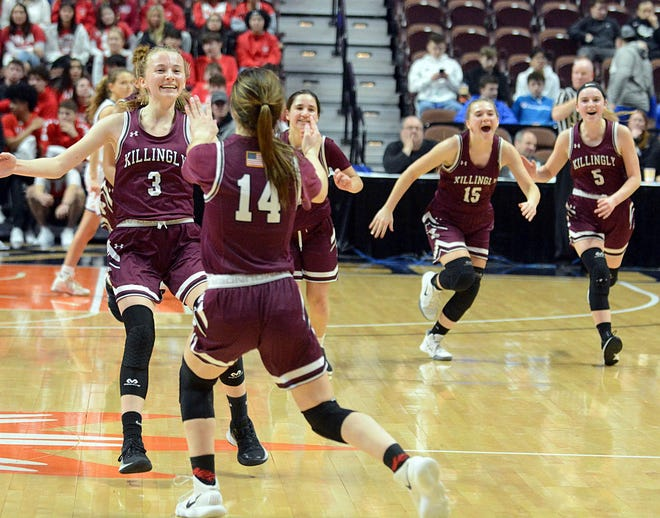 Killingly players, including Ella Lach (3) and Sophia Moore (14), celebrate their 55-49 win over Putnam in last year's ECC Division II championship at the Mohegan Sun Arena.