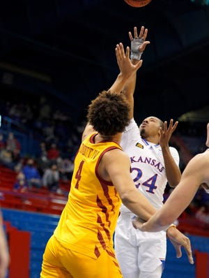 Kansas basketball guard Bryce Thompson shoots over Iowa State's George Conditt during the first half of Thursday night's game at Allen Fieldhouse in Lawrence. Playing in only his second game since Dec. 22, Thompson pitched in 8 points, 4 rebounds, 3 assists and 2 blocks in the Jayhawks' 97-64 victory.