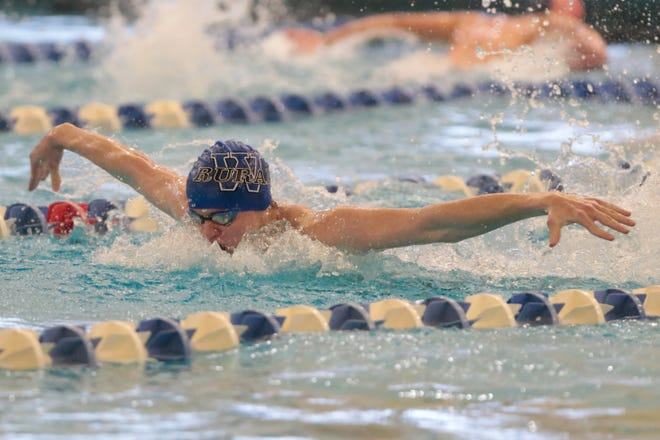 Washburn Rural's Nathan Trachta wins the 100-yard butterfly with a time of 54.15 at Thursday's Centennial League Championships at Capitol Federal Natatorium.