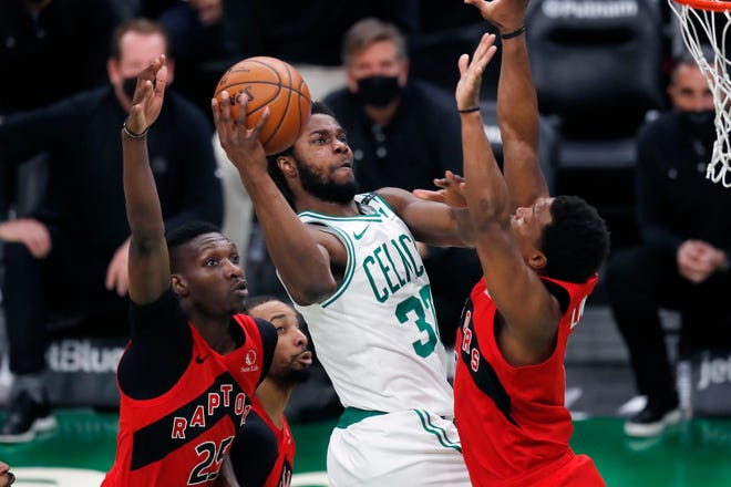 Boston's Semi Ojeleye shoots against Toronto's Chris Boucher (25) and Kyle Lowry during the second half of Thursday's game.