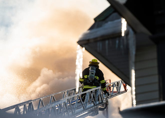 Crews battled a three-alarm fire and icy conditions at 14 William St. Friday morning.
