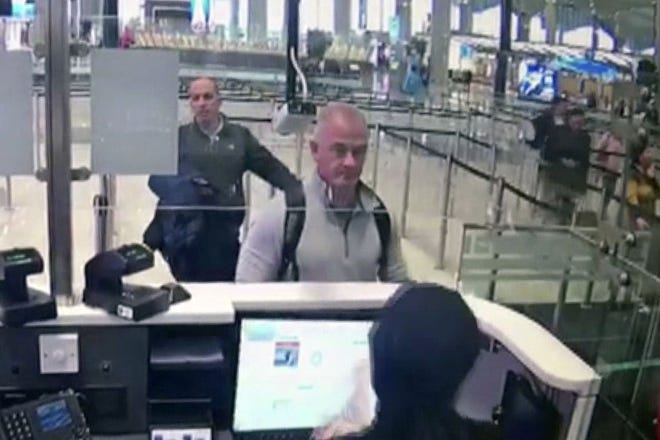 This Dec. 30, 2019, image from security camera video shows Michael L. Taylor, center, at passport control at Istanbul Airport in Turkey. Taylor is accused of smuggling former Nissan Motor Co. Chairman Carlos Ghosn out of Japan in 2019 while he was awaiting trial on financial misconduct charges.
