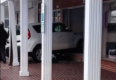 A Kia rests in the window of a vacant shop in the Eutaw Shopping Center. Witnesses said it appeared that the driver was confused.
