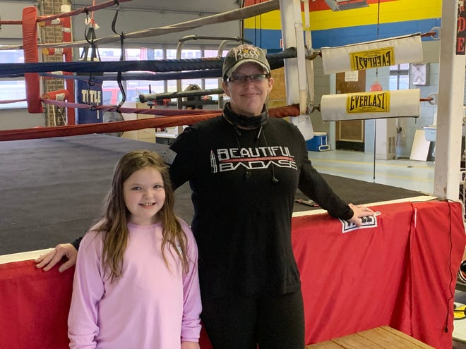 Brandi McCain, Alabama's only female boxing promoter, is pictured with her daughter, Palin, 7, at Crossroads Boxing Gym. McCain says she has no desire to go into the ring, but that her daughter enjoys boxing.