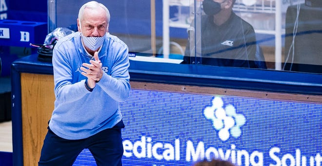 Coach Roy Williams offers encouragement during North Carolina's defeat of Duke last weekend at Cameron Indoor Stadium.
