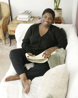 Tuskeegee-born Angela Johnson poses for a portrait at her home in Kent, Ohio, Wednesday Oct. 1, 2003.  Johnson, author of more than 40 books of poetry, young adult novels, and children's stories celebrating African-American culture and history, is the 2021 winner of the Harper Lee Award.