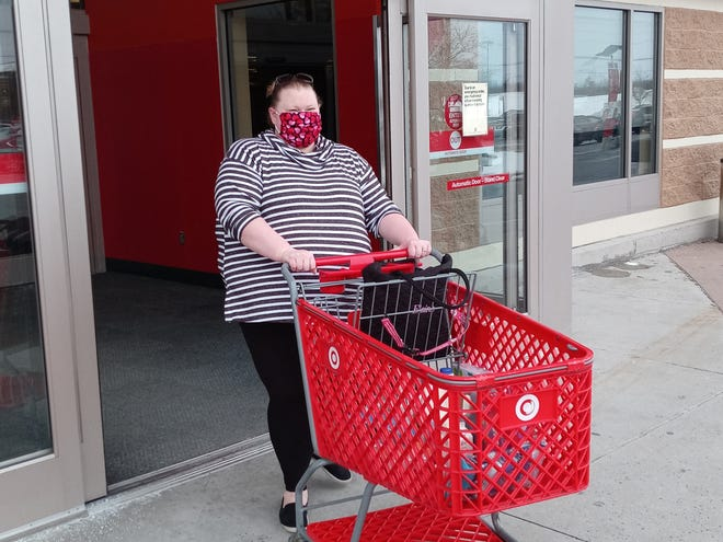 Elaine Harless goes shopping for her clients as part of her errand delivery service.