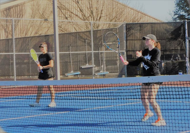 A girls' doubles team from Ennis High School participates in last week's Highway 287 tennis tournament in Ennis.