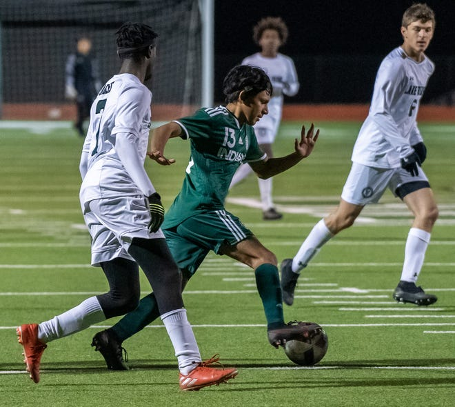 Waxahachie's Yordi Sevilla (13) controls the ball during a recent home match against Mansfield Lake Ridge. The Indians got back on track on Tuesday night with a 2-1 win over Mansfield High.