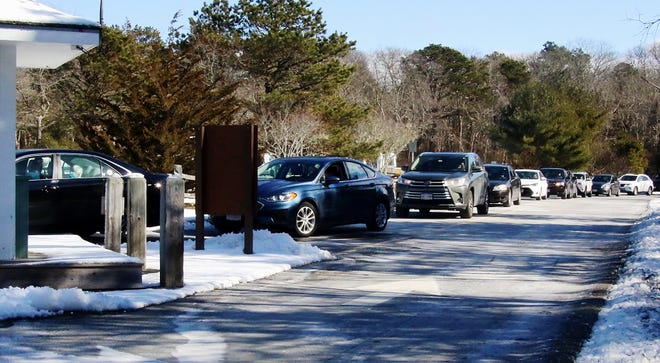 Cars line up at the Eastham clinic Friday, when 375 doses were available for those who pre-registered to obtain the Pfizer vaccine.