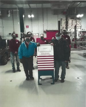 Blue Hills Regional Technical School students repaired a flag disposal mailbox, which was damaged by a snowplow, for the veterans of American Legion Braintree Post 86.
