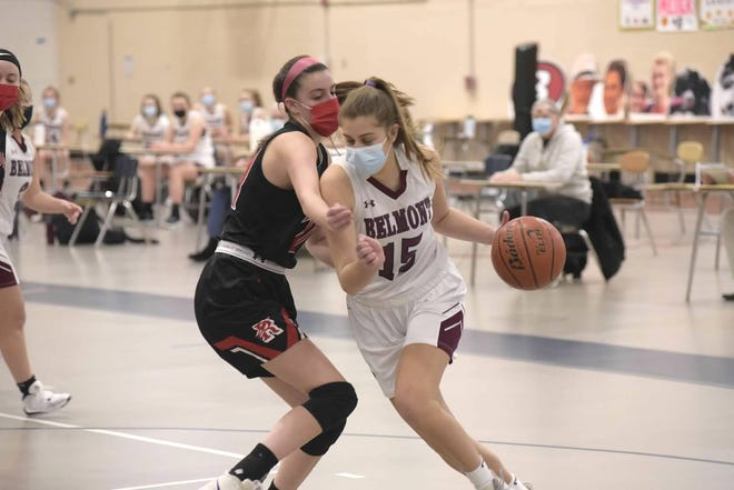 Senior Addie Wagner dribbles past a Woburn player.