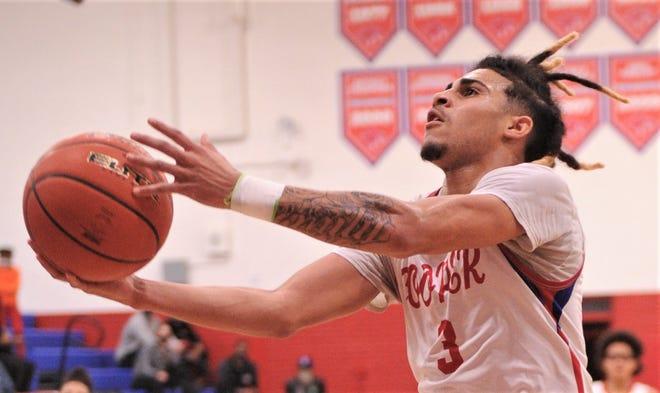 Cooper guard Noah Garcia drives for a basket against Lubbock Monterey.