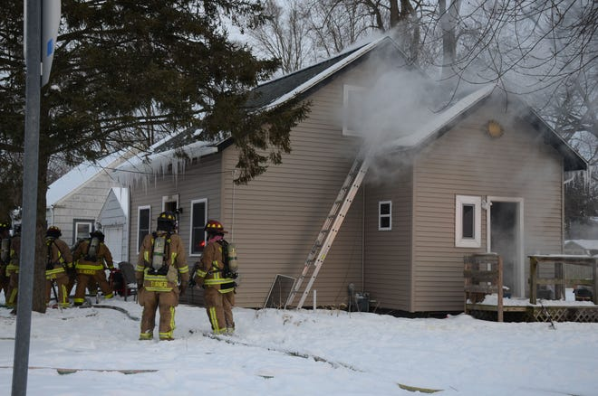 Battle Creek firefighters at the scene on West Goguac Street Thursday.