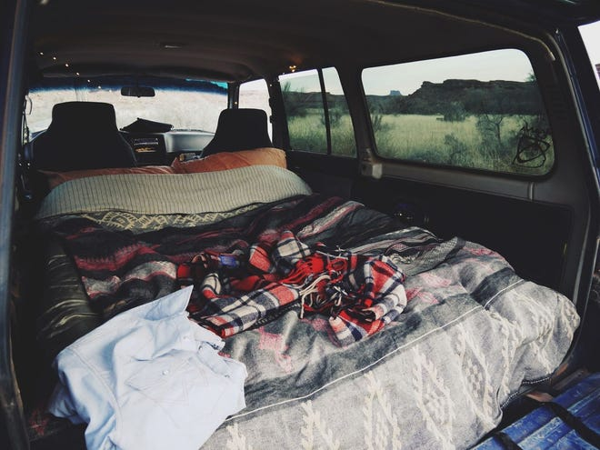 Transform your backseat into a space that you can camp in.