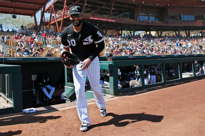 FILE - In this Monday, March 9, 2020 file photo, Chicago White Sox's Nomar Mazara heads out of the dugout for a spring training baseball game against the Cincinnati Reds in Glendale, Ariz.