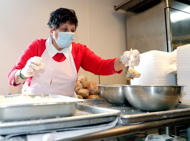 Pat Smits breads perch at the Redwood Inn in Ledgeview for the restaurant's Friday fish fry on Feb. 12.