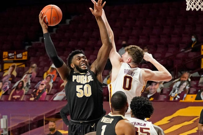 Purdue's Trevion Williams (50) shoots over Minnesota's Liam Robbins (0) in the second half of an NCAA college basketball game, Thursday, Feb. 11, 2021, in Minneapolis. (AP Photo/Jim Mone)